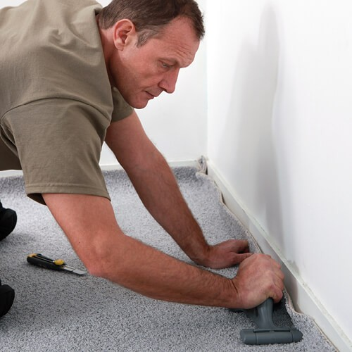 Man installing carpet | McCurleys National Flooring